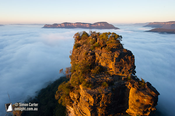 The Jamison Valley, Blue Mountains, blanketed by an inversion layer with Mount Solitary in the background. NSW, Australia.