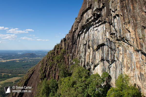 Lee Cujes and John J O'Brien attempting to free climb pitch two of the Beerwah Bolt Route.