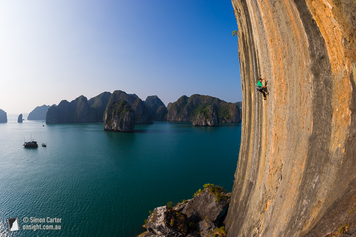 Lee Cujes making the first ascent of License to Climb Harder (7c), on The Face -- one of 2153 limestone karsts in Ha Long Bay, Vietnam.
