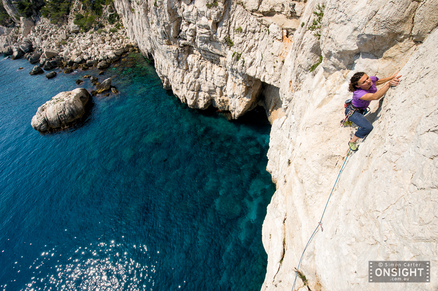 "Nadine Rousselot leading the final pitch of the nine pitch traverse La Commune (6b) at Les Calanques, on the Mediterranean, in the south of France. The route actually starts from the rocky ""beach"" in the background!"