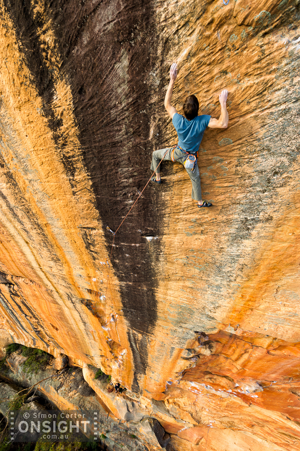 """Ethan Pringle attempting the The Groove Train (33/34) which he described as """"the best hard route he'd ever been on"""". He made the second ascent of this rather run-out route a few days later. It's on Taipan Wall in the Grampians, Australia."""