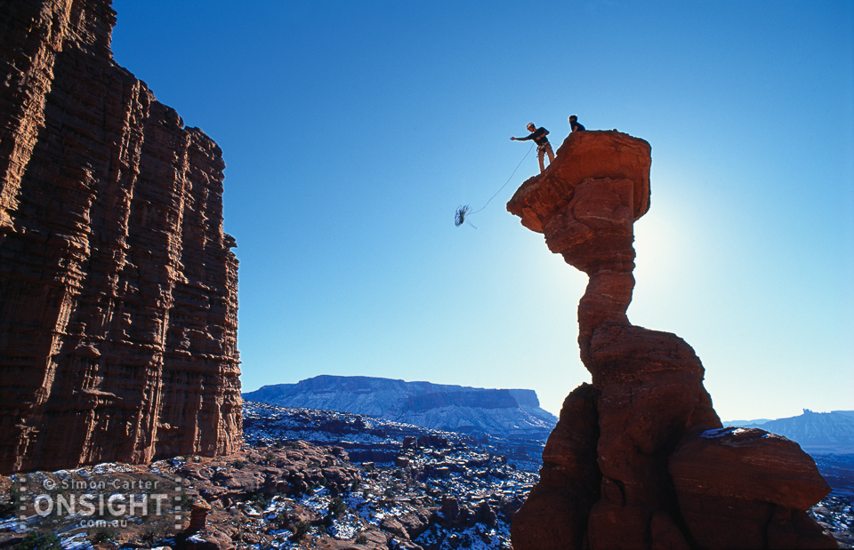 Time to go home…. Chris Donharl prepares the abseil from The Cobra (5.11R) in the Fisher Towers, near Moab, Utah, USA.