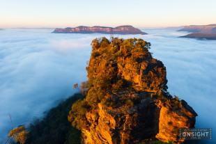 The Jamison Valley blanketed by an inversion layer with Mount Solitary in the background. Blue Mountains, NSW, Australia.