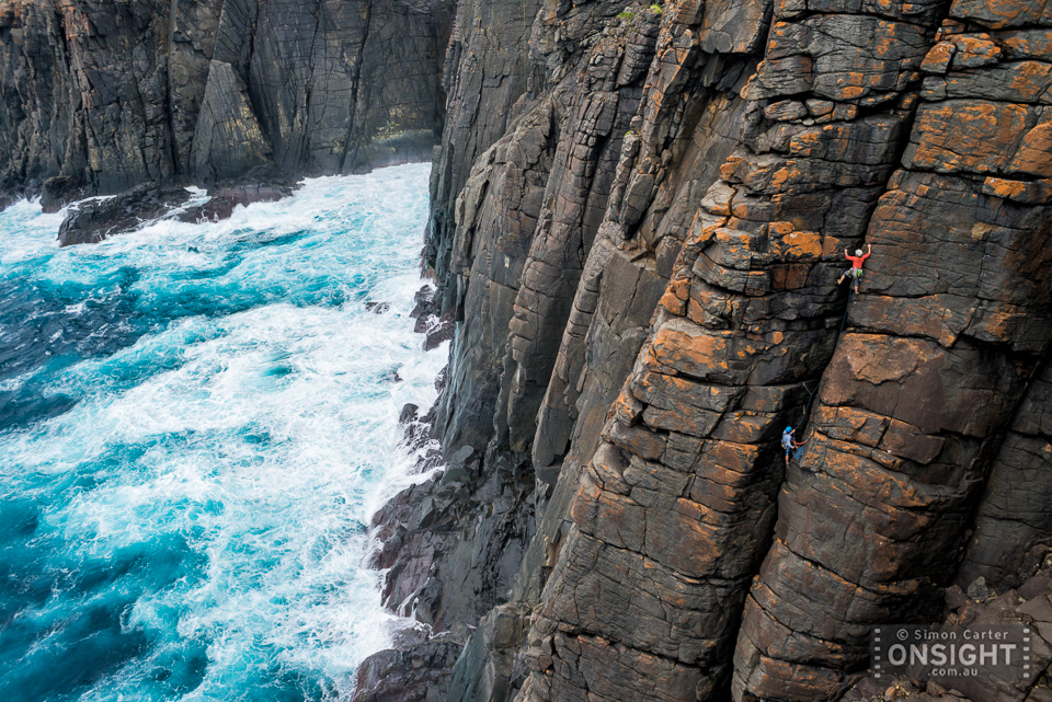 Ali Chapman with Ashlee Peeters belaying, pitch two Southern Ocean Swell (12, 12), Southern Ocean Wall, West Cape Howe, Western Australia.
