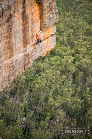 "Flint Duxfield leading pitch 8 (the ""Spine Chiller traverse"") of Big Nose (26), 250m, Pierce's Pass, Blue Mountains, NSW, Australia."