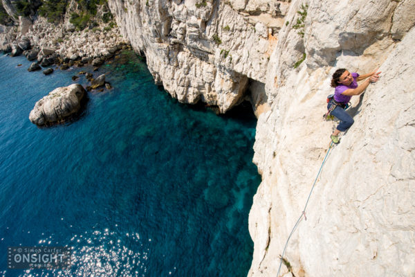 "Nadine Rousselot leading the final pitch of the 9 pitch traverse La Commune (6b) at Les Calanques, on the Mediterranean, in the south of France. The route actually starts from the rocky ""beach"" in the background!"
