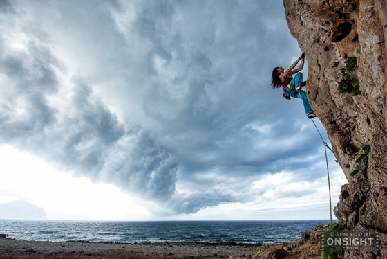 Anna Torretta, who guided with us on our World Expeditions trip, climbing literally before a storm.